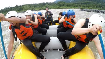 выживание : Group of nine asiatic people white water rafting rowing at full speed, on board camera with sound,model released Стоковые видеозаписи