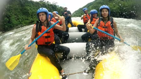 evezés : River rafting boat with happy group of seven girls included audio from onboard camera