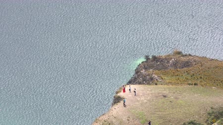equador : Unidentified person taking pictures of themselves at Quilotoa lagoon, static aerial shot