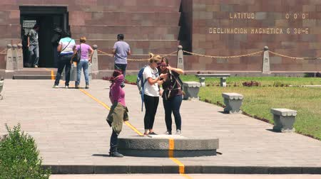 quito : QUITO, ECUADOR - 2 APRIL 2015: Visitors at Center Of The World monument in QUITO on APRIL 2, 2015 Stock Footage