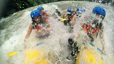 adrenalin : Team of seven girls on river rafting experience slow motion 120fps