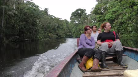 amazonka : Group of tourists enjoying the Amazonian basin of Ecuador from motorized canoe
