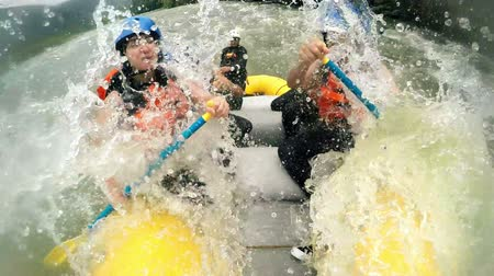 evezés : Immersive shot of rough whitewater rafting trip from onboard camera slow motion 120fps Stock mozgókép