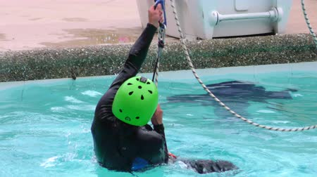 contender : BANOS, ECUADOR - 23 MAY 2015: Canyoning instructor swimming pool zip line demonstration in BANOS on MAY 23, 2015 Stock Footage