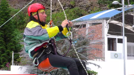 contender : BANOS, ECUADOR - 23 MAY 2015: Canyoning senior instructor auto rescue technique demonstration in BANOS on MAY 23, 2015 Stock Footage