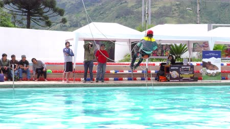 contender : BANOS, ECUADOR - 23 MAY 2015: Canyoning senior instructor auto rescue technique demonstration for Santa Ana summer festival in BANOS on MAY 23, 2015