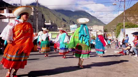 indigene : BANOS, ECUADOR - 01 JUNE 2015: Alumnae wearing traditional costumes dancing at their school 100th anniversary in BANOS on JUNE 01, 2015