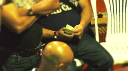 cockfight : High Stakes Gambler Counting Dollar Bills At Cockfight Tournament