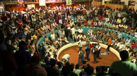 cock fights : Banos, Ecuador - 06 February 2016: Hundreds Of People Gathered At Public Cockfight Arena Before The Fight In Banos On February 06, 2016