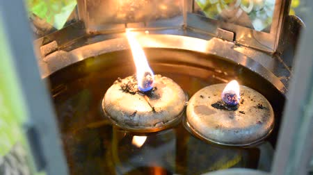 suporte : Close up oil lamps in the temple of Thailand. Use for light the candle. Stock Footage