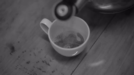 coffee press : Pouring hot water into coffee cup black and white color tone Stock Footage