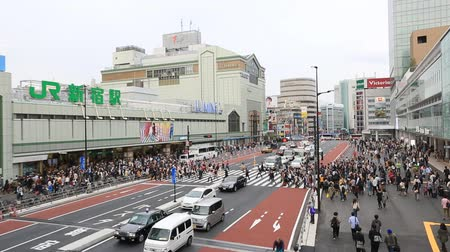 Tokyo, Japan - April 9, 2016: People for street crossing at Shinjuku JR Railway Station. Shinjuku Station is one of the busiest station in Tokyo. Japan.