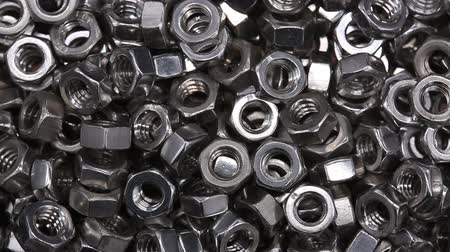 çinko : Close up a bunch of metal nuts for industrial needs. Metal products.