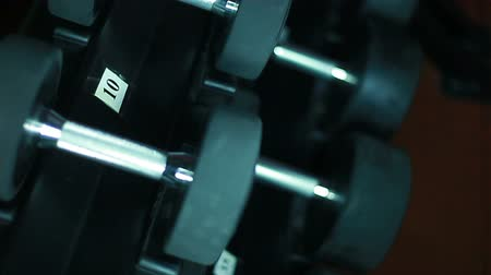 sakk : Lots of dumbbells in the gym.