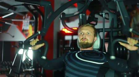 Athlete swinging on the simulator.