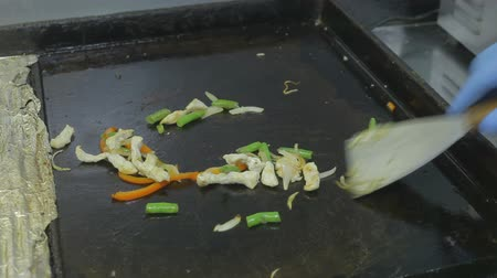 Cook roasts vegetables.