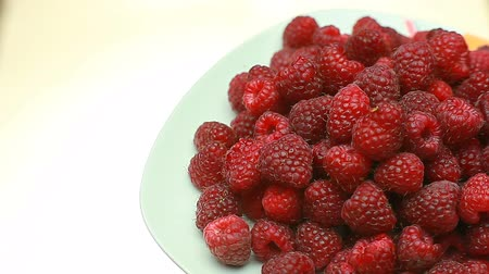 Fresh raspberry fruits as food background. Healthy food organic nutrition. View from above