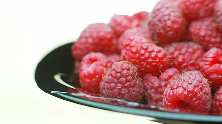 Fresh raspberry fruits as food background. Healthy food organic nutrition. frontal view