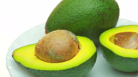 avocado : Ready-to-eat avocados. . On a white background lies the fruit avocado as a background.