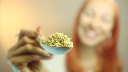 eat background : Fresh Green Sprouts Buckwheat in the spoon Closeup. Young Beautiful Woman Eating Sprouts Buckwheat. Raw Healthy Organic Diet. Healthy Vegetarian Eco Food concept, Dieting