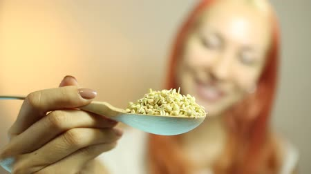 germinated : Fresh Green Sprouts Buckwheat in the spoon Closeup. Young Beautiful Woman Eating Sprouts Buckwheat. Raw Healthy Organic Diet. Healthy Vegetarian Eco Food concept, Dieting