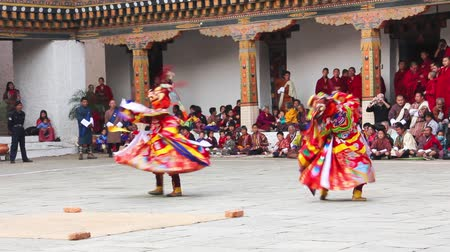 bhutan : masked dancers at  drupchen festival in the dzong of Punakha, Bhutan. Drupchen festival is taking place yearly in march. Stock Footage