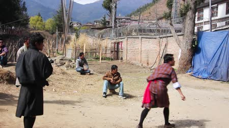 bhutan : dart players in bhutan.Playing darts is the second national sport of bhutan. At lhosar, the bhutanese new year,  many of the men participate in  dart games. Stock Footage
