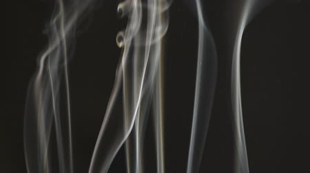 ладан : incense smoke on dark background