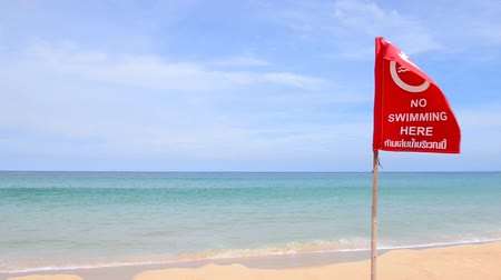 caution sign : No swimming danger sign at the beach Stock Footage