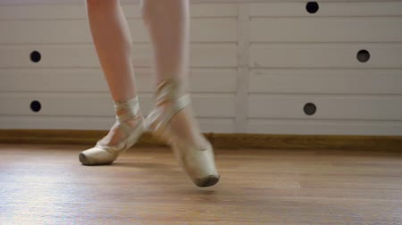Close up of a ballet dancers feet , dancer practices point exercises.