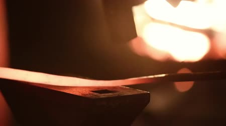 forging sword : Smith beats the hammer on a metal workpiece