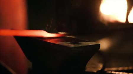 forging sword : Smith beats the hammer on a metal workpiece. Slowmotion