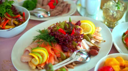 буфет : buffet: salads, meat and fish dishes are on the table.