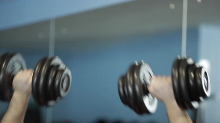 lift ups : fitness: a man is at the gym Stock Footage