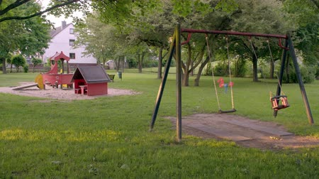 an empty Playground with swings.