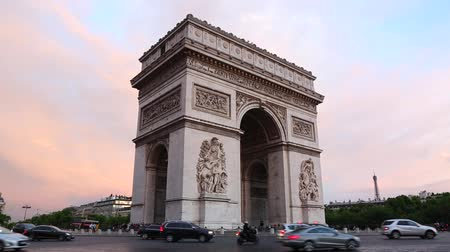 Arc de Triomphe in Paris at dusk with traffic, France