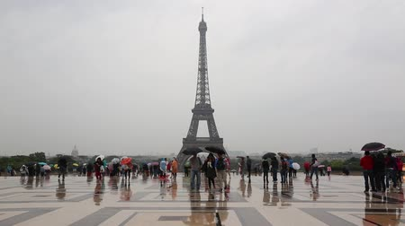 Paris, Eiffel tower view with tourists in a rainy day