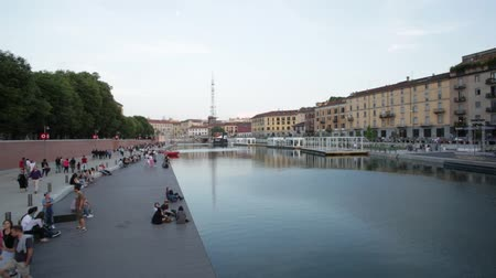 yeniden yapılanma : Milan new Darsena, redeveloped docks area in the afternoon, people walking and chatting on May 30, 2015 in Milan Italy. The Darsena, the canal port closed since 1979 was reopened in April 2015.