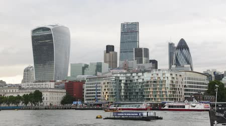 London skyscrapers skyline view in the afternoon, boat passing with Thames river on August 5, 2015 in London.