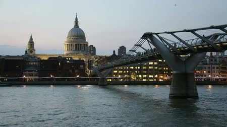 St Pauls cathedral and Millennium bridge in London in a clear evening