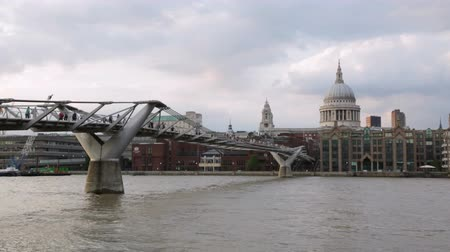 St Pauls cathedral and Millennium bridge in London in a cloudy afternoon