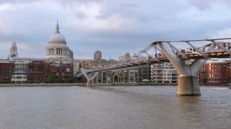 St Pauls cathedral and Millennium bridge in London in the afternoon Stock mozgókép