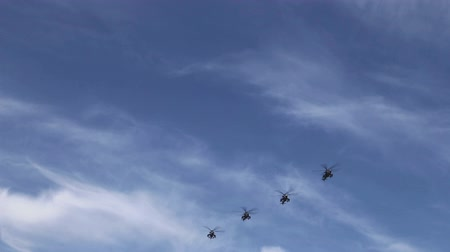 arma curta : military assault helicopters Mi-35 flying formation at the beautiful blue sky