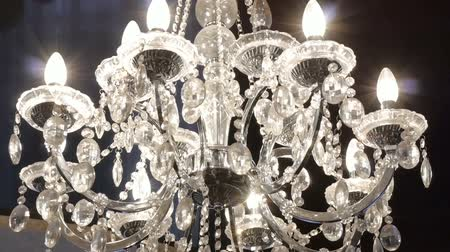 eleganckie : Beautiful hanging crystal chandelier on ceiling. Smooth camera track right.
