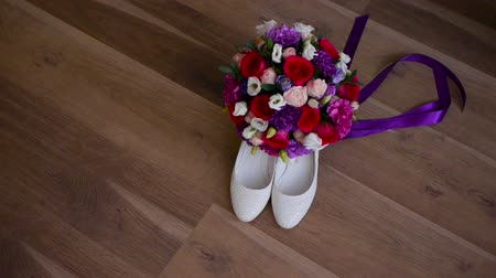 footgear : bridal bouquet and brides shoes. Stock Footage