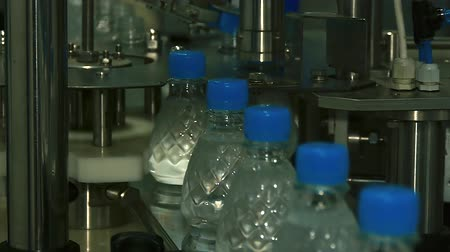 plastics : plastic bottles move along the conveyor