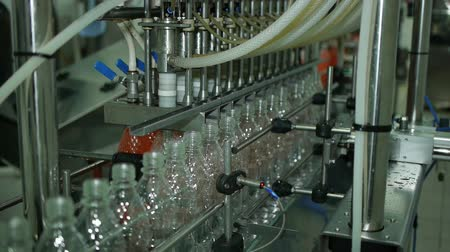 limonada : production of plastic bottles of mineral water lemonade. spilling water bottles. assembly-line production environmentally friendly production warehouse with the products Stock Footage