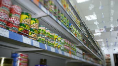 grocery : shelves with food at the supermarket