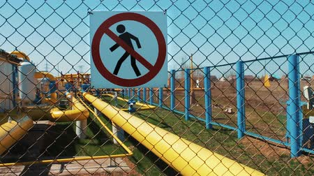 езда с недозволенной скоростью : A station for purification and processing of natural gas. Transportation and distribution of petroleum products. Sign of danger. Unauthorized entry is prohibited. Gas sensors. Security system. Pipeline for transportation of natural gas and oil products. P