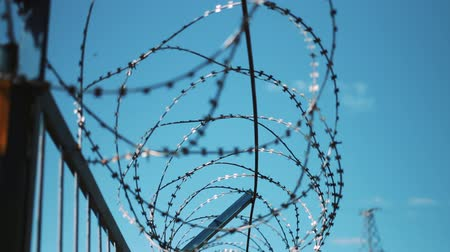 езда с недозволенной скоростью : Barbed wire fence. restricted area. Closed territory. Warning of danger. Protection from penetration and escape. The passage is closed. Unauthorized entry is prohibited.